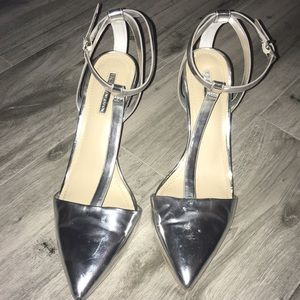 BCBG Generation Chrome T strap pointy Heals